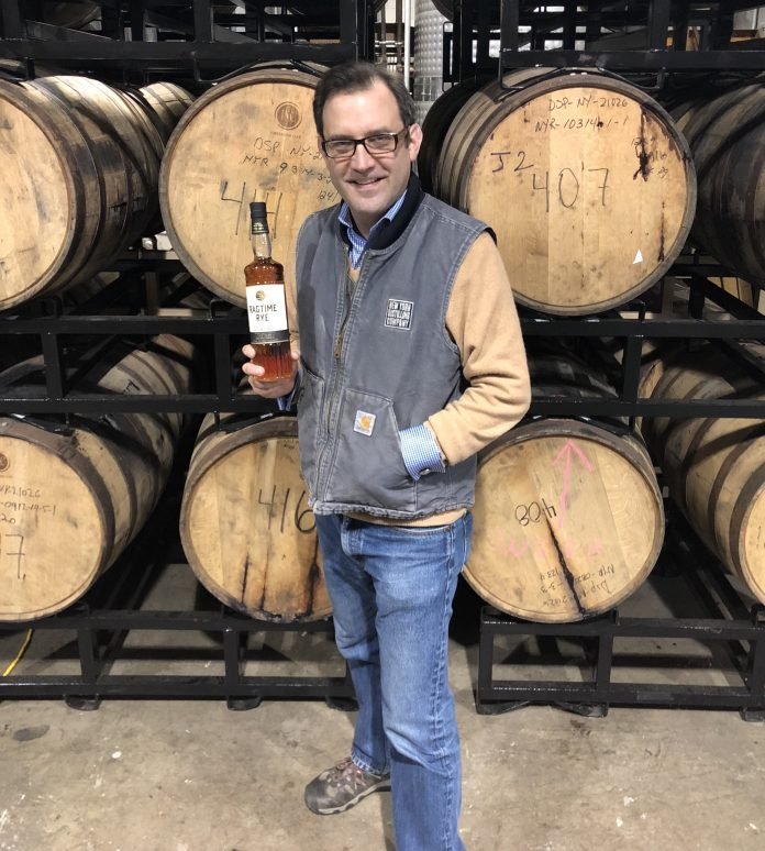 Allen Katz with a bottle of Ragtime Rye. Courtesy New York Distilling Company.