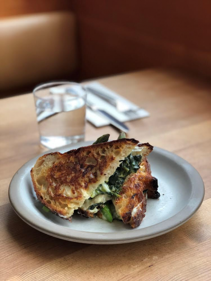 Tartine Manufactory Grilled Cheese Sandwich with Cowgirl Creamery Wagon Wheel, Mornay, Asparagus, Mint, Fava Greens & Spring Onions on Tartine Country Bread.