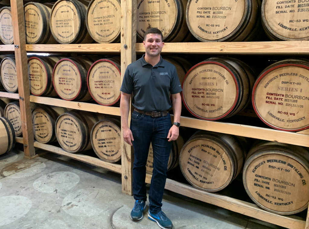 Master Distiller Caleb Kilburn stands in the warehouse he helped build at Kentucky Peerless Distilling Co.