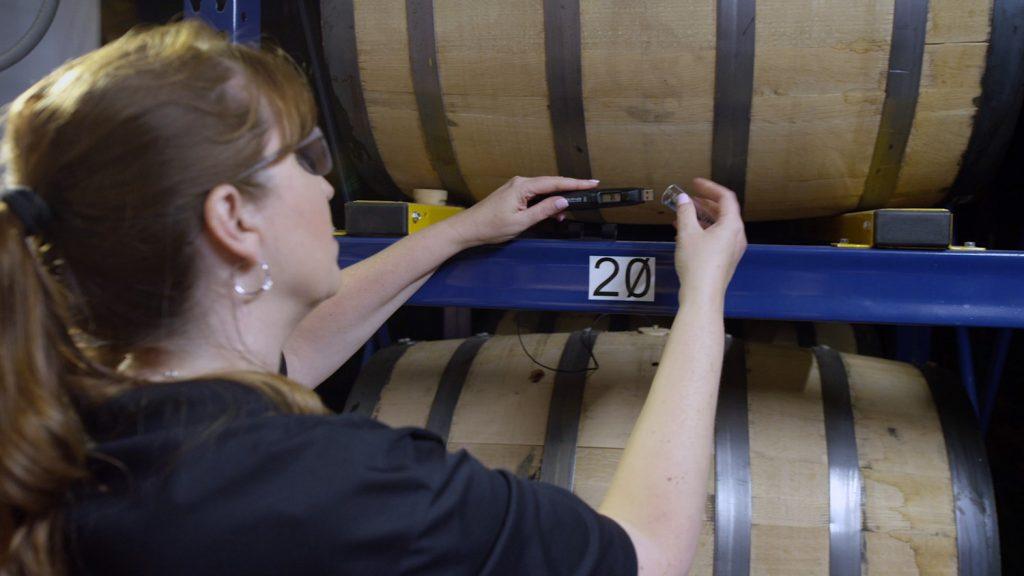 Andrea Wilson inspects barrels