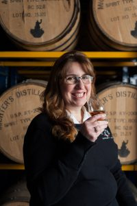 Andrea Wilson drinking Michter's bourbon
